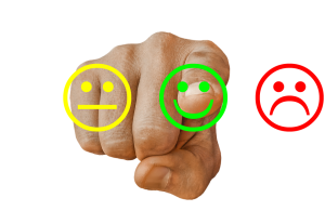 Photo of finger point at good, poor, and neutral emojis