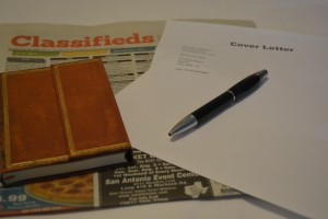 Photo of cover letter and classifieds section of newspaper